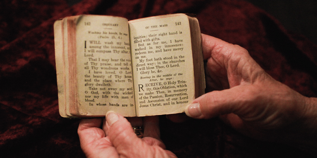 Hands holding an opened Bible.