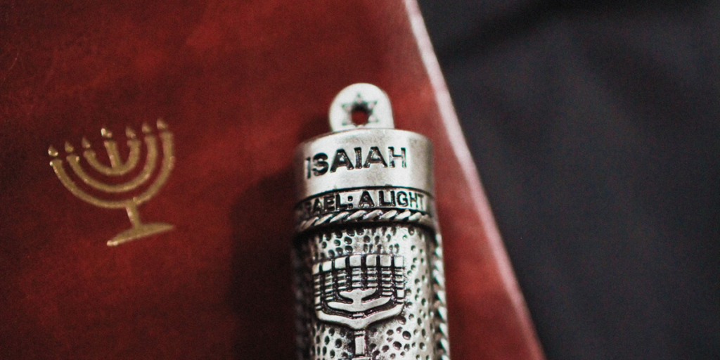 Isaiah Mezuzah on unopened Jewish Bible.